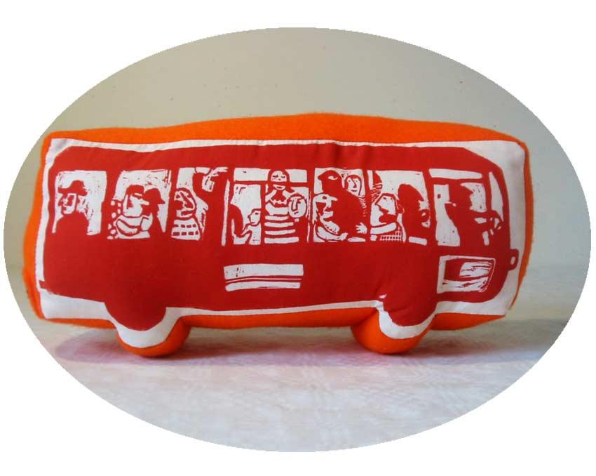Travel pillow © Magali Bardos linocut on fabric felt travelers rush hour red illustration